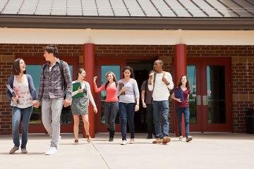 High school students leaving school building